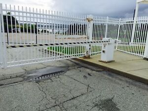 Automated vehicular security gate with stop and go light for commercial building $2,000.00