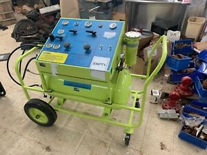 A gas Remtec Defender 2000 M 1 Halon 1211 Recovery Recharge System 500 Lb