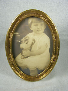 Victorian Oval Easel Back Embossed Bow Brass Picture Frame Girl With Plush Toy