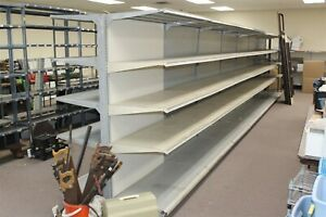 28 X 72 Tall Double Sided Gondola Shelving 7 4 Sections W 22 Shelves