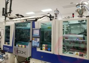Krauss Maffie 2 Shot Injection Molding Machine With Rotary Table Robot