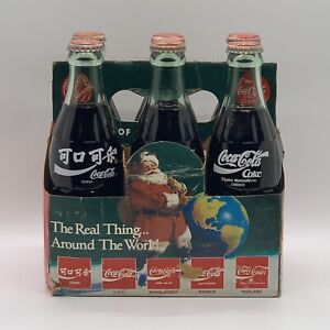1990 COCA COLA 6 PACK BOTTLES NEVER OPENED CHRISTMAS AROUND THE WORLD (1 Pack)