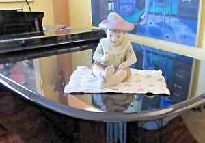 Vintage Ceramic Piano Baby Wearing A Feathered Hat Holding An Apple