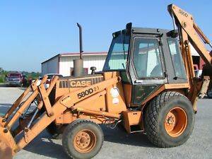 Case 580 D Backhoe Tractor Loader Used In A Cemetary