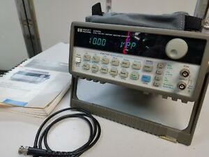 Hewlett Packard Hp 33120a 15mhz Function Arbitrary Waveform Generator With Book