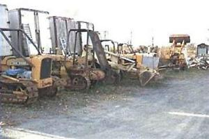 A Collection Of 7 John Deere 1010 Crawlers And Loaders Plus Parts