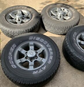2000 2004 Tires And Rims Nissan Frontier Xterra 15 Aluminum Gray W Caps 2wd