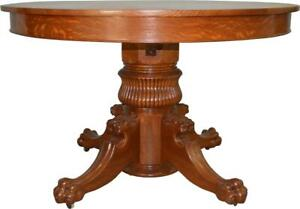17111 Tiger Oak 48 Round Lion Head Dining Table
