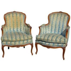 Pair Of Louis Xvi Style Walnut Carved Upholstered Bergeres