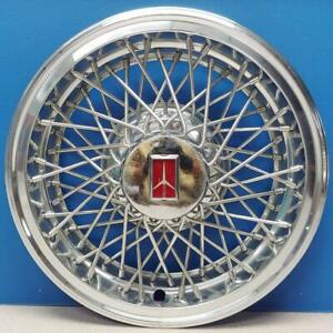 One 1982 1988 Oldsmobile Cutlass 4094 14 Wire Hubcap Wheel Cover 22515281