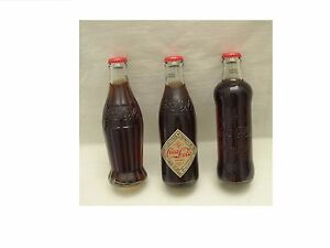 COCA COLA CYPRUS BOTTLES  2011 COMPLETE SET  FOR 125 YEARS FULL GLASS BOTTLES