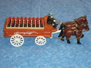 Coca Cola Cast Iron Wagon with Clydesdales Driver and Cola Bottles