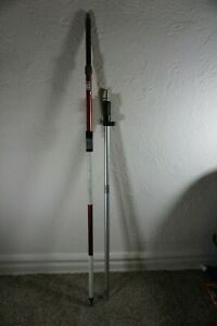 Two Surveying Poles Telescoping Grade Rod And Lietz Prism Pole