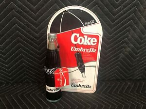 1985 Coca Cola New Old Stock Coke Bottle Shaped Umbrella with Display Sign