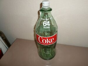 1974 COCA COLA 64 OZ. BOTTLE WITH RED LOGOS AND WHITE CAP
