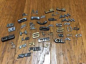 Lot Of Miscellaneous Various Auto Vehicle Emblems Letters Numbers