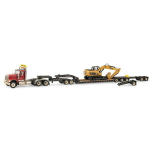 1 50 International Hx520 Truck And Xl 120 Trailer With Dusty Cat Excavator 85613