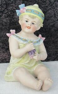 Antique German Bisque Porcelain Piano Baby Figurine Girl With Grapes