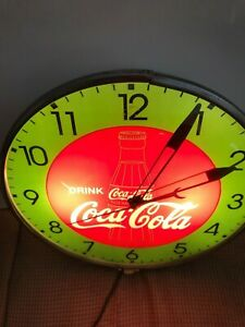 1948 COCA COLA CLOCK.  GREEN FACE WITH GOLD BOTTLE