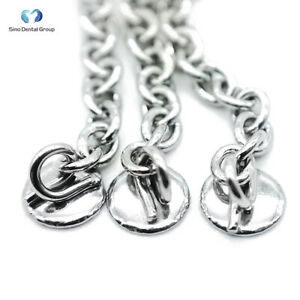 50pcs Sino Dental Orthodontic Eruption Appliance With Round Traction Chain