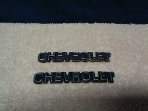 2 vintage nos oem 1975 75 Chevy Nova Sail Panel Emblems