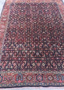 An Antique Persian Halvaei Bijar Rug