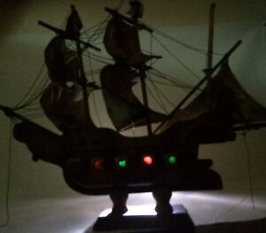 Vintage Hand Made Model Ship Wooden Ship Cloth Sails And Lighted Port Holes