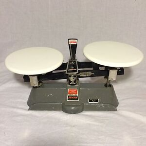 Vintage Hoyas Scale With Porcelain Tops And Small Counter Weights