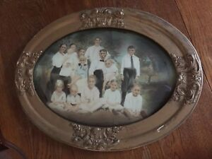 Antique Early 1900s Family Portrait Large Oval Wood Frame With Convex Dome Glass