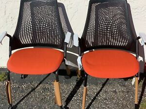 One Herman Miller Sayl Side Chair W casters
