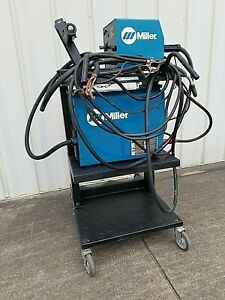 Miller Xmt 304 Cc cv W 22a Feeder Complete Mig Package On Miller Migrunner Cart