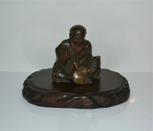Antique Japanese Pigmented Bronze Artisan Figure Okimono Wood Stand
