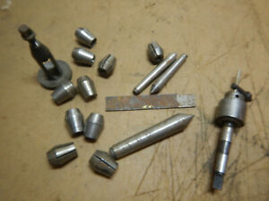 Pile Of Metal Lathe Tooling Collets Tool Post Centers From A Shop With Atlas 618