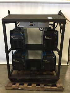 Bundle Of 4 Miller Xmt 304 Cc cv Welders Multi Process W Miller Welding Rack