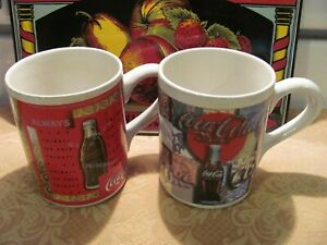 (2) 14 Oz. Coca-Cola Mugs By Gibson*VGC* Bold & Bright Colors Two Patterns