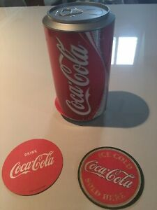 vintage Coca Cola coasters in a can