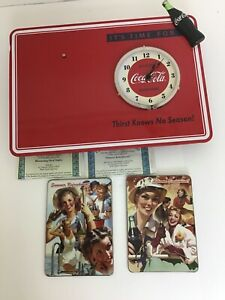 Bradford Exchange Coca-Cola Wall Clock With Summer And Autumn Display.