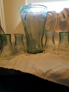 Vintage coca cola glass pitcher with ice lip and 4 matching small 4oz. glasses