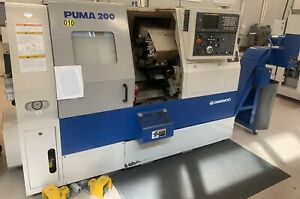 Doosan Daewoo 200c Cnc Lathe With Spacesaver 2000 Bar Feeder Extremely Nice 1998