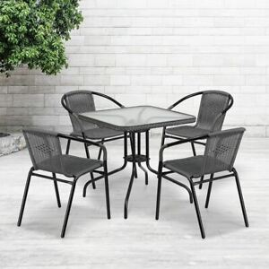 D28 Square Glass Metal Table W gray Rattan Edging 4 Gray Rattan Stack Chairs