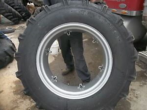 Two International B414 Tractor 14 9x28 14 9 28 8 Ply Tires W 6 Loop Wheels