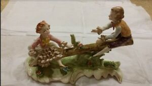 11 Dresden Style Hand Painted Figure Of A Boy And Girl On Seesaw