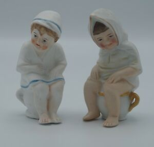 Bisque Boy And Girl Piano Baby Sitting On Chamber Pots Figurine Antique