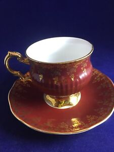 Rosina Footed Tea Cup And Saucer Brownish Red And Gold Gilt On Cup And Saucer