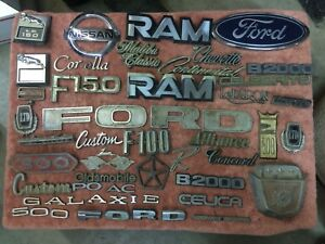 Vintage Emblem Parts Lot Galaxie Ford Custom Ram Chevette Used 35 Plus Pieces