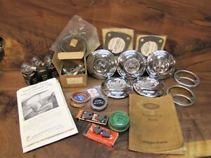 Lot Of Misc 1928 31 Ford Model A Parts Hubcaps 1928 Manual Frame Bolts Etc