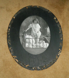 Vintage Oval Wooden Frame With Bw Picture Of Girl In Nightgown In Brass Bed