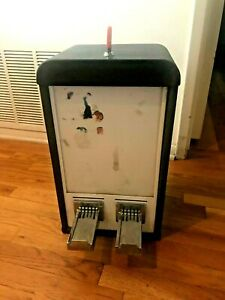 A a 2 Column Sticker Machine Used Working Condition 50 Cent Lock Key Black