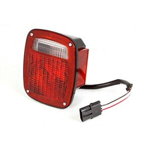 Omix ada 12403 14 Tail Light Assembly In Black Fits 91 97 Jeep Wrangler Tj Yj
