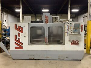 Used Haas Vf 6 Cnc Vertical Mill 1998 28 X 64 Table Cat 50 Chip Auger
